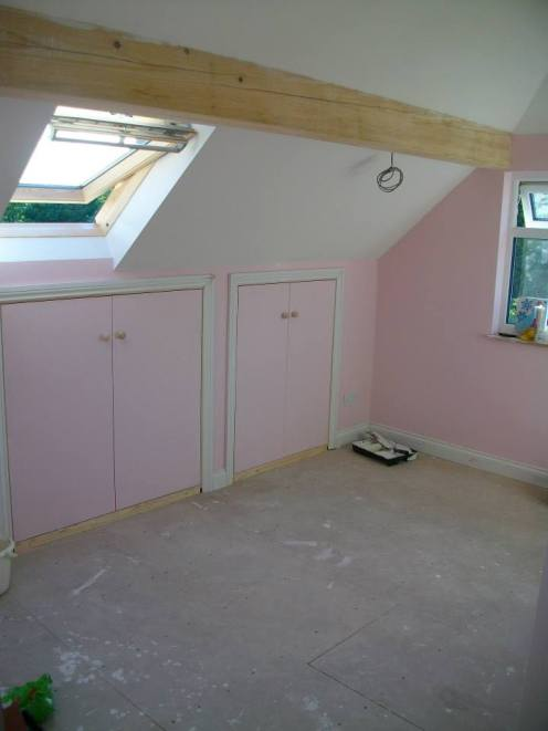 painting-pink-bedroom-cupboards