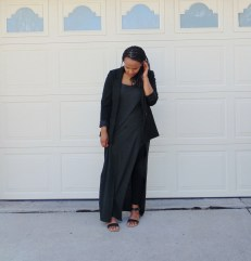 black blazer dark gray maxi dress with high slit black leggings black strappy heels