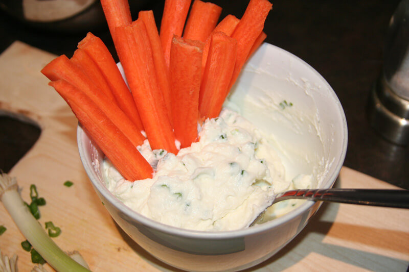 Milk kefir cheese dip with green onions and carrots.