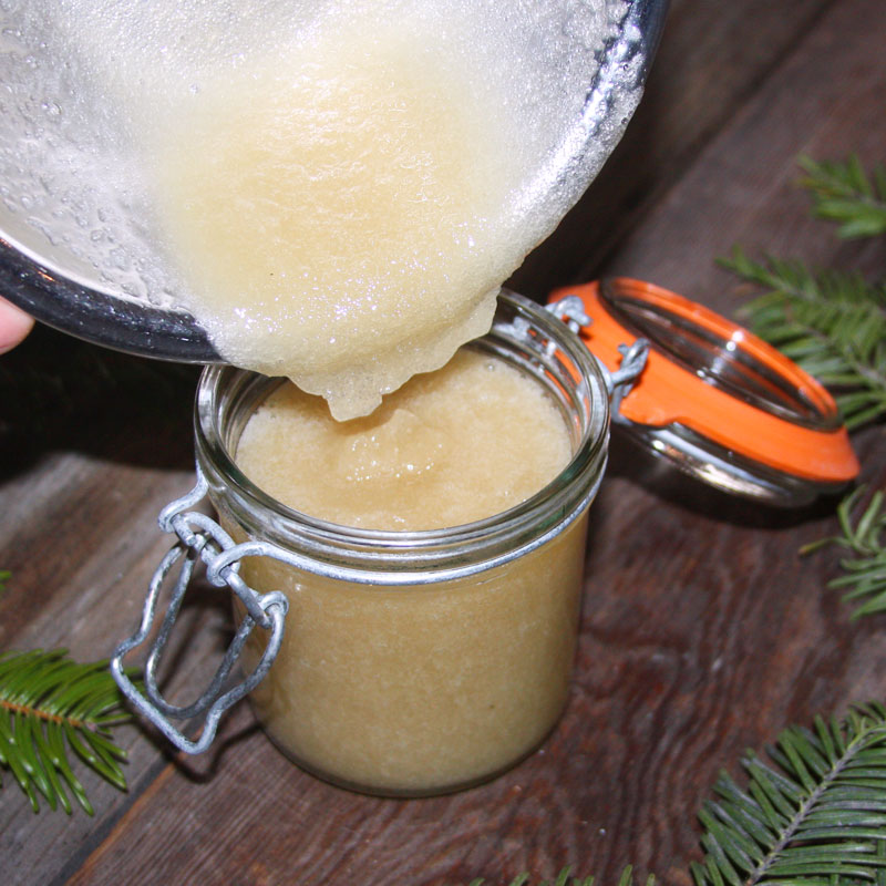 Packaging up homemade sugar scrub in a one cup weck jar with clasp.