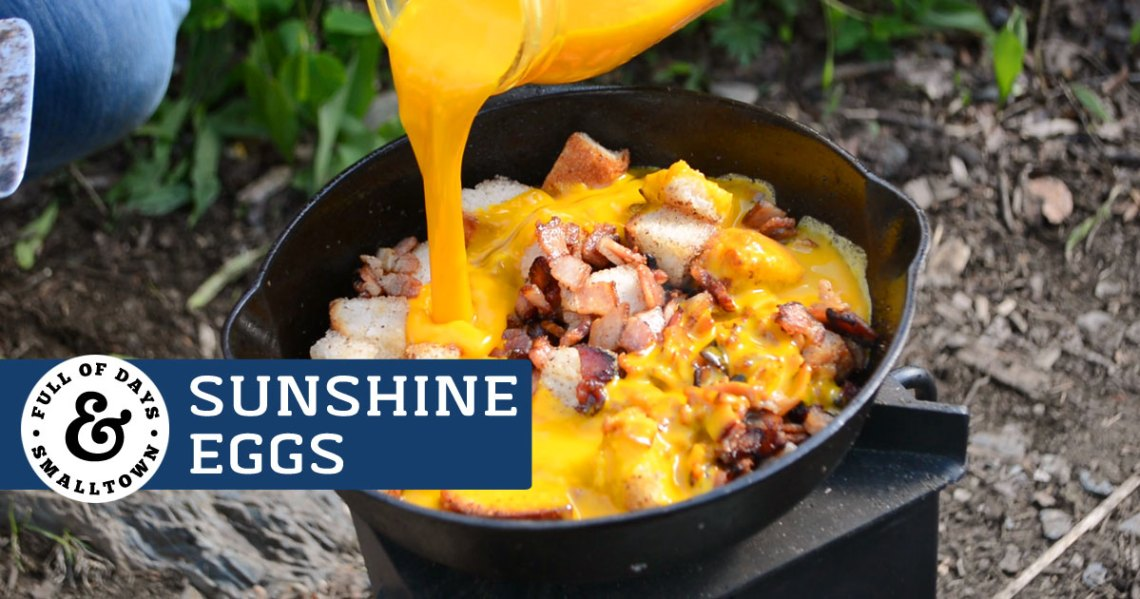 Sunshine Eggs Camping Breakfast Image Shows Being Poured Into A Cast Iron Pan With
