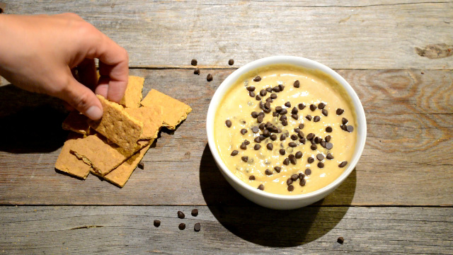 Healthy cookie dough dip in a bowl with graham crackers for dipping.
