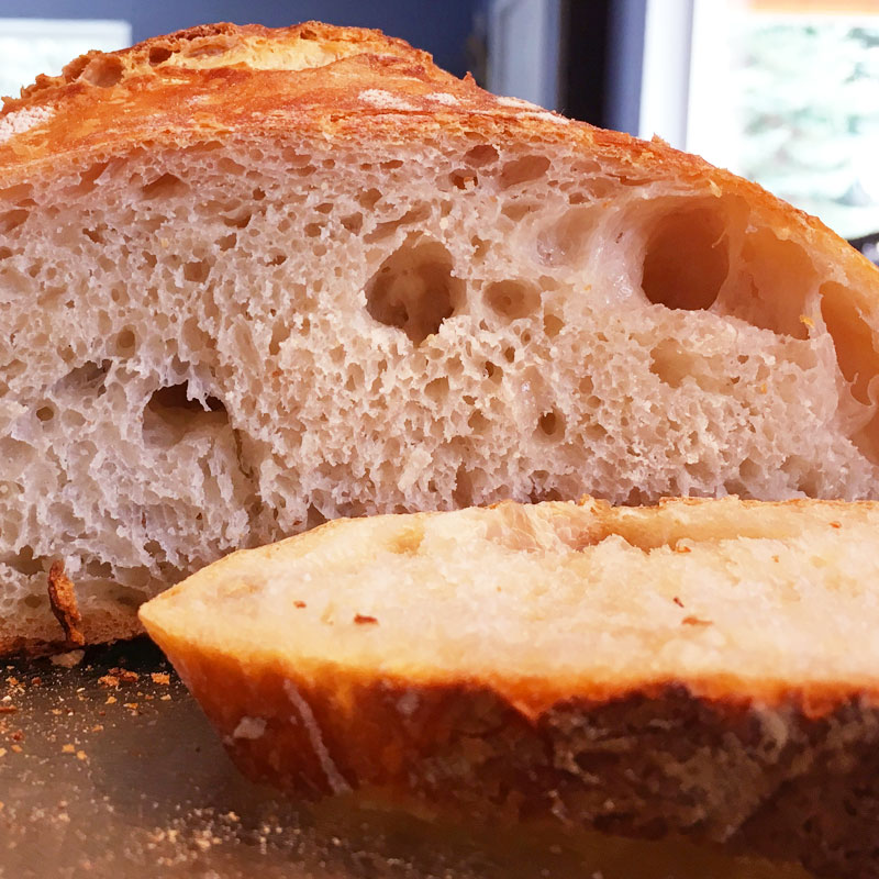 Once cooled, slice into that bread and see the rewards from all your effort! Look at that crumb!