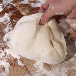 Gently bring the dough to the center while also grabbing the dough at 12 o'clock and bringing both sides together.