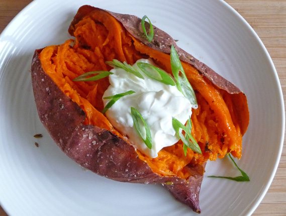 Slow Roasted Sweet Potatoes with Garlic Labneh from Michael Solomonov