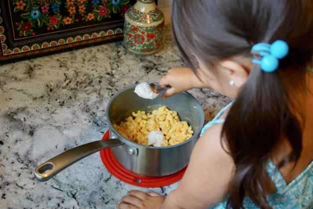 My daughter making boxed mac and cheese