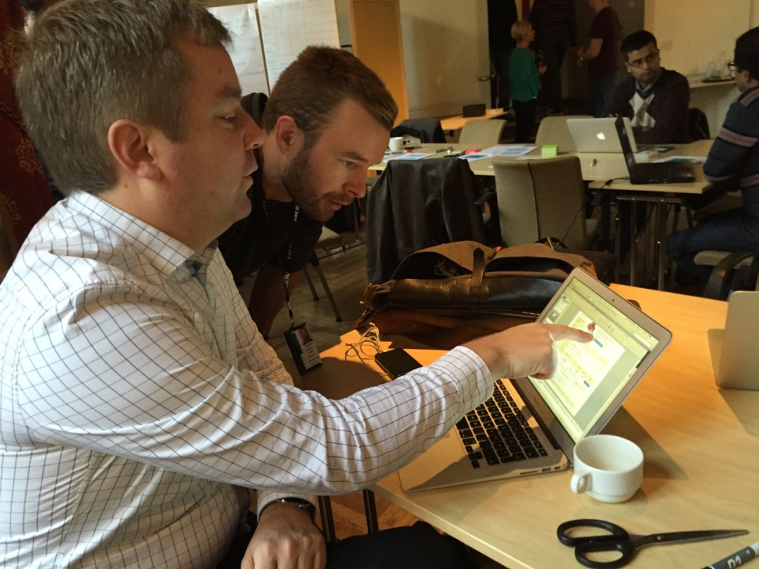 Two colleagues working together on a laptop