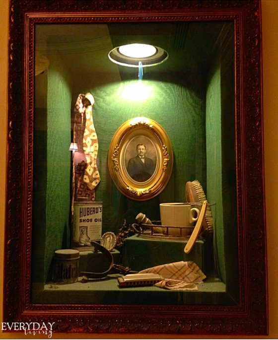 Shadowbox of antique items hanging in our hallway