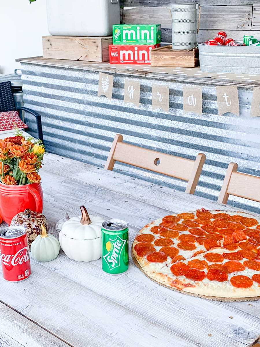 Fall Table with Pizza and Coca Cola and Sprite