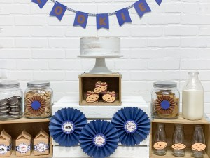 Party Table White Cake Cookies Paper Rosettes Blue Banner