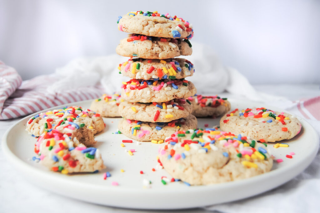 Vegan Rainbow Sprinkle Cookies on a white plate