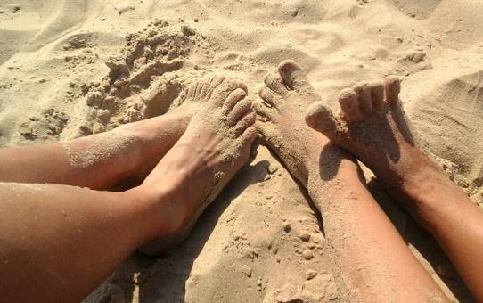 Photo of feet and legs on a beach
