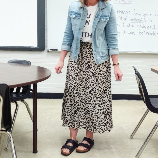 Teacher outfit featuring leopard print skirt, graphic tee, and denim jacket