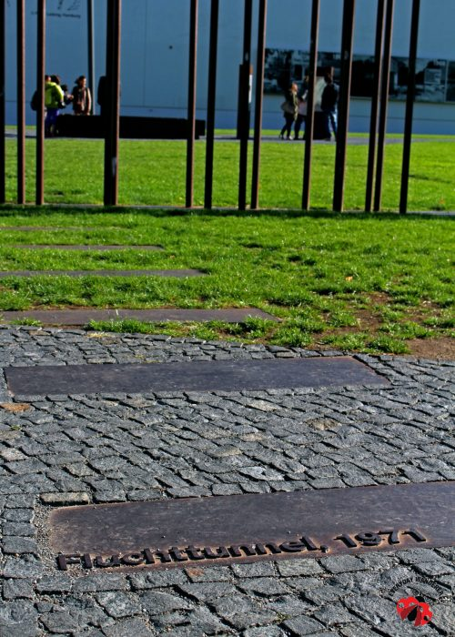 Red, steel rods indicate where the Berlin Wall once stood
