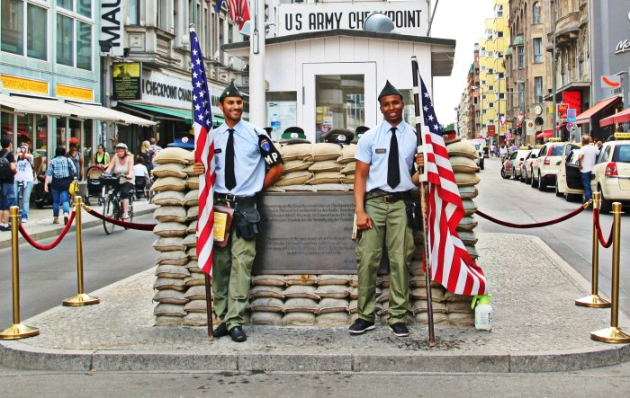 Actors serve as guards at Checkpoint Charlie in Berlin, Germany