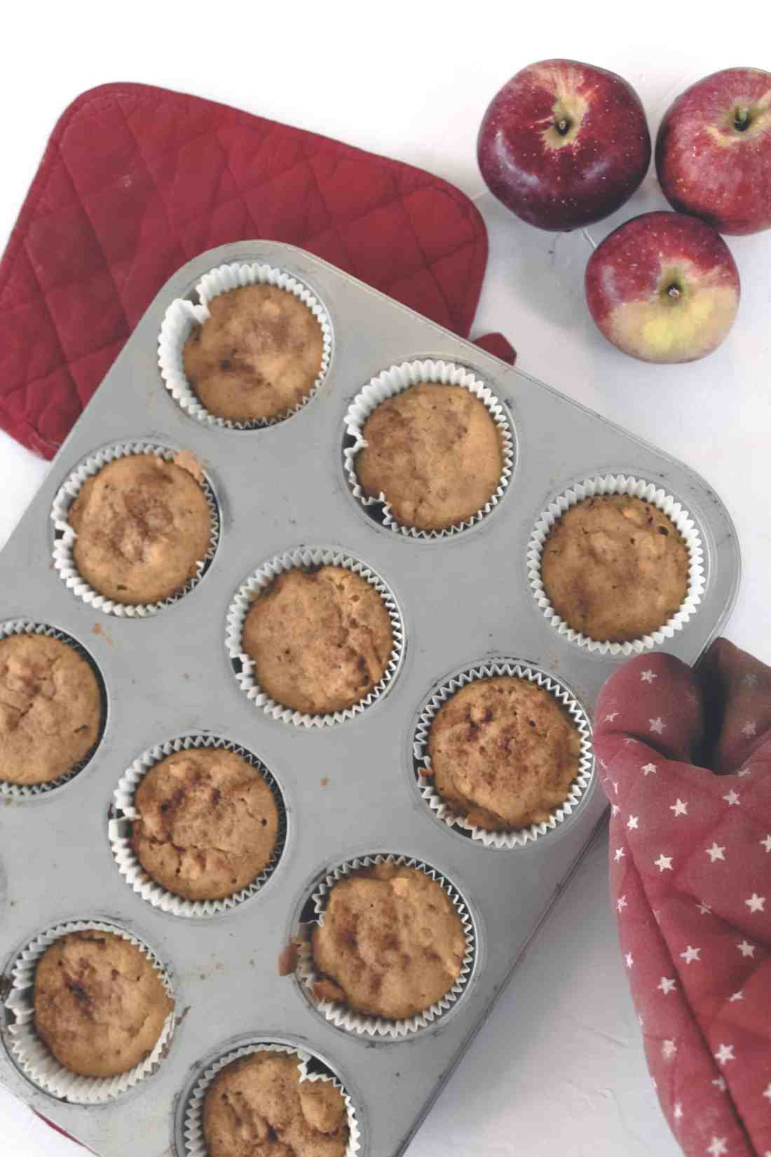 These gluten free pumpkin apple muffins are vegan, naturally sweetened, & take less than 35 minutes to make. Makes for a great breakfast, snack, or dessert!