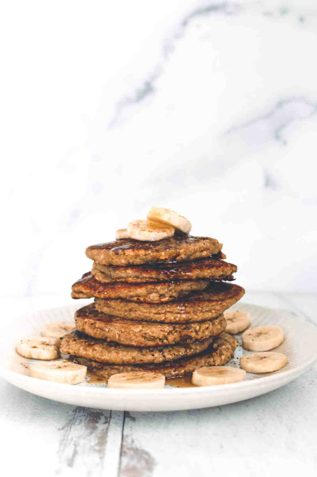 These naturally gluten free & vegan banana blender pancakes are filling, delicious, & make for a really easy & healthy breakfast everyone will enjoy!