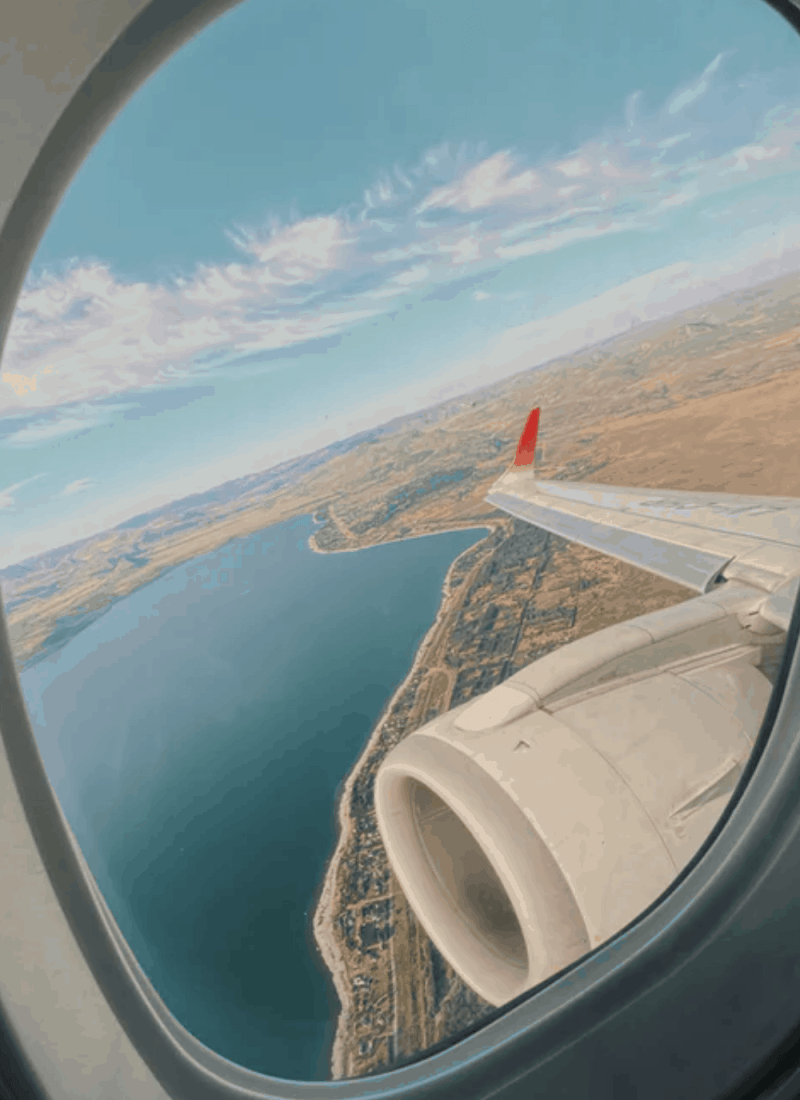 View from an airplane window in the sky.