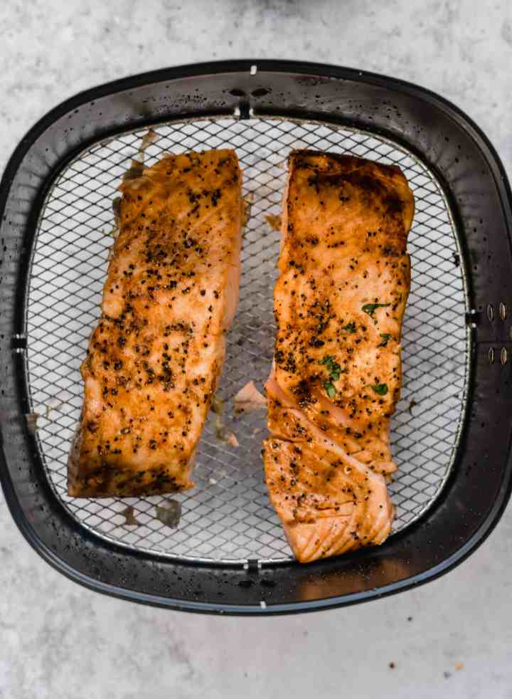 Air fryer salmon cooked in air fryer basket