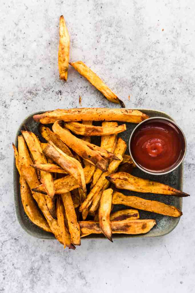 Air Fryer Sweet Potato Fries on grey plate with ketchup