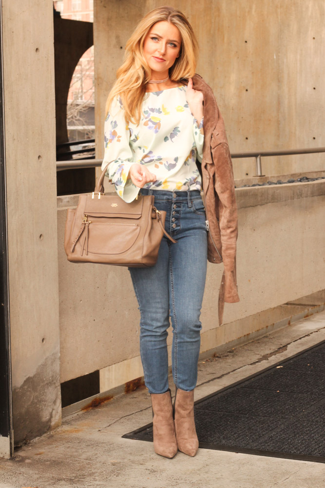 Amber from Every Once in a Style is wearing Banana Republic ruffle top and a moto jacket
