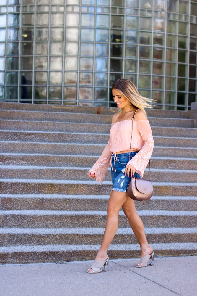 amber from every once in a style wearing | off the shoulder lace top | denim mini skirt | rose gold bag