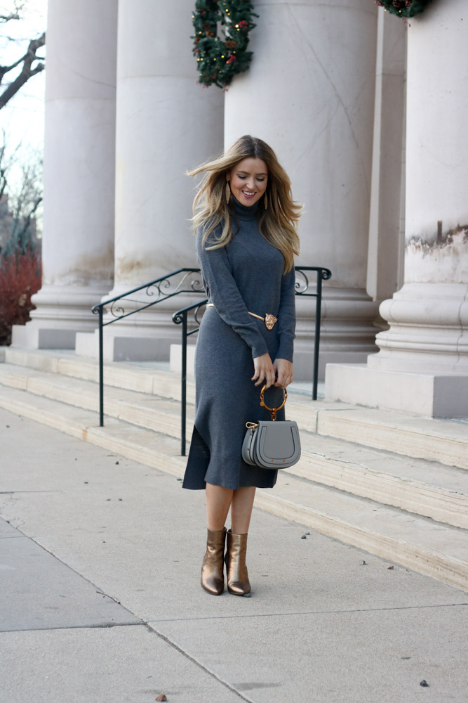 amber for every once in style is wearing a sweater dress from banana republic
