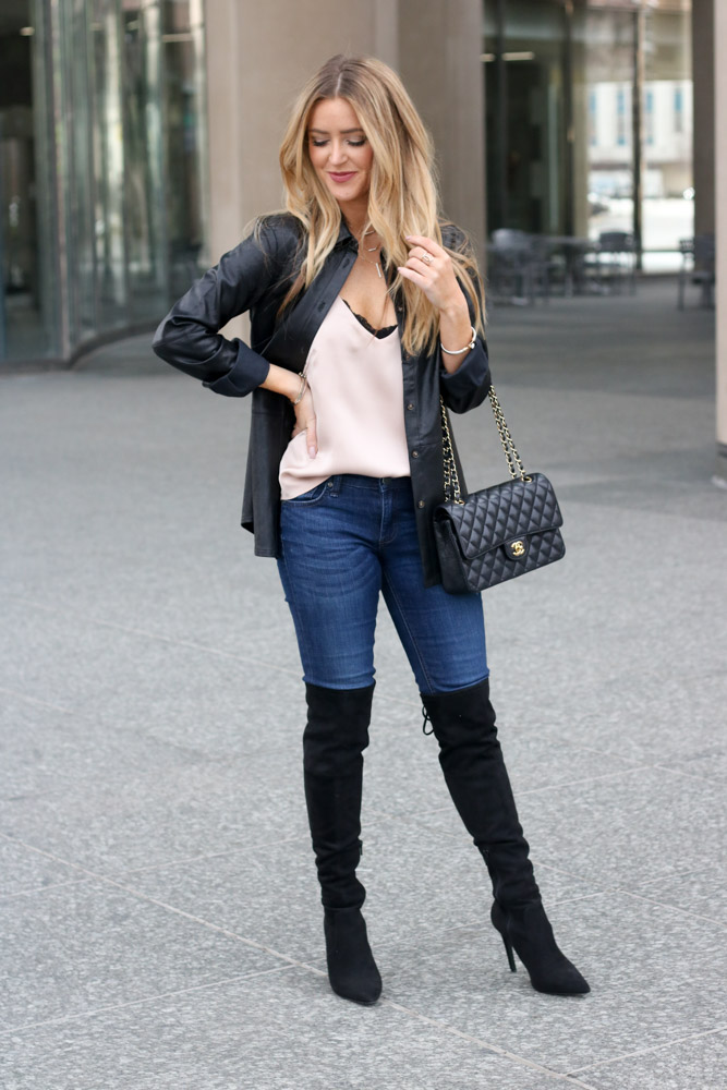 Amber from Every once in a style is wearing over the knee boot and a chanel bag