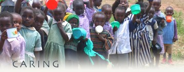 orphans lining up for a meal in Kampi Ya Moto