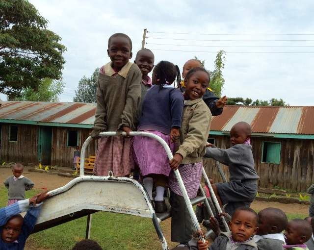 preschoolers on the slide at Lanet Umoja
