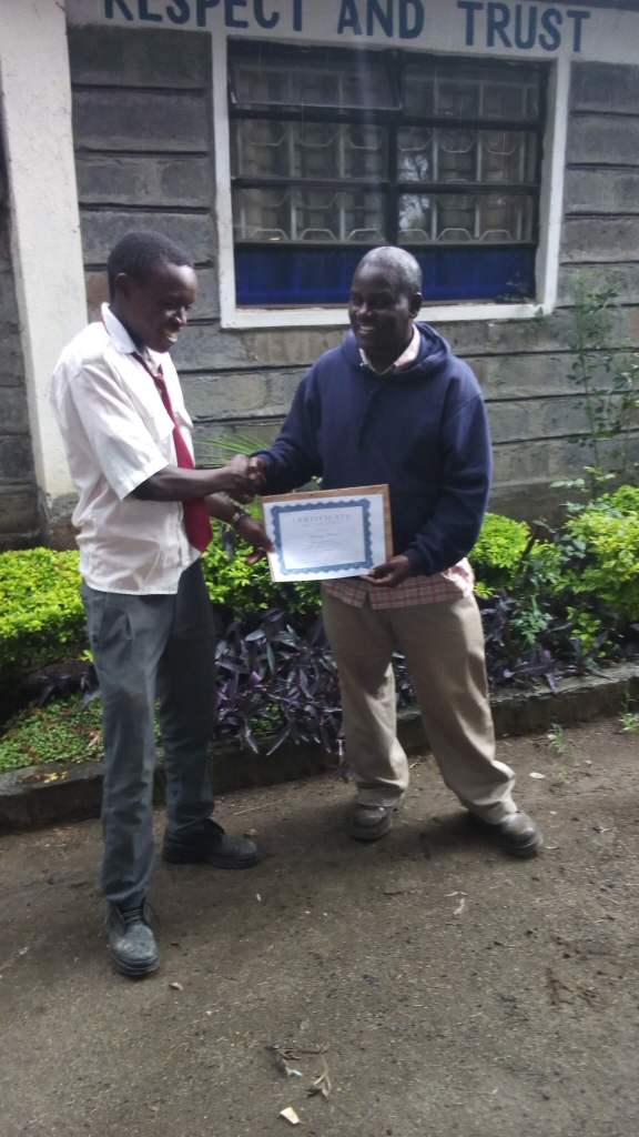 Anthony receiving his Certificate of Completion of the EC Mentorship Program