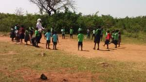 Children playing outside with their teacher at Miruya Primary School in western Kenya