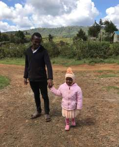 Kenyan child in a warm jacket