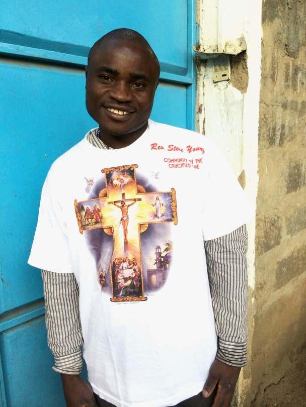 young Kenyan man with a new t-shirt bearing the cross
