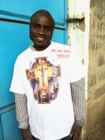 young Kenyan man with a new t-shirt bearing the cross