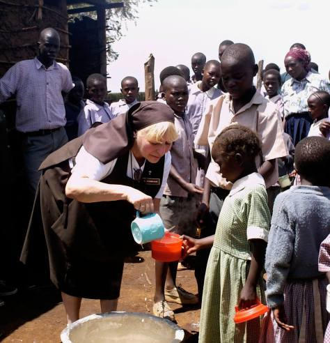 Sr. Kateri feeding the hungry children in Kenya