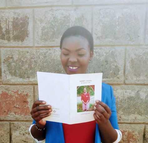 Jedidah reading her story Jedidah's Journey