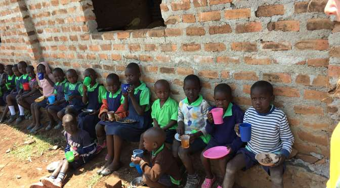 The Lord has something to say: Feeding children: Children eating lunch at Miruya Primary School