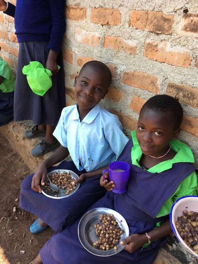 feeding children at Miruya Primary School