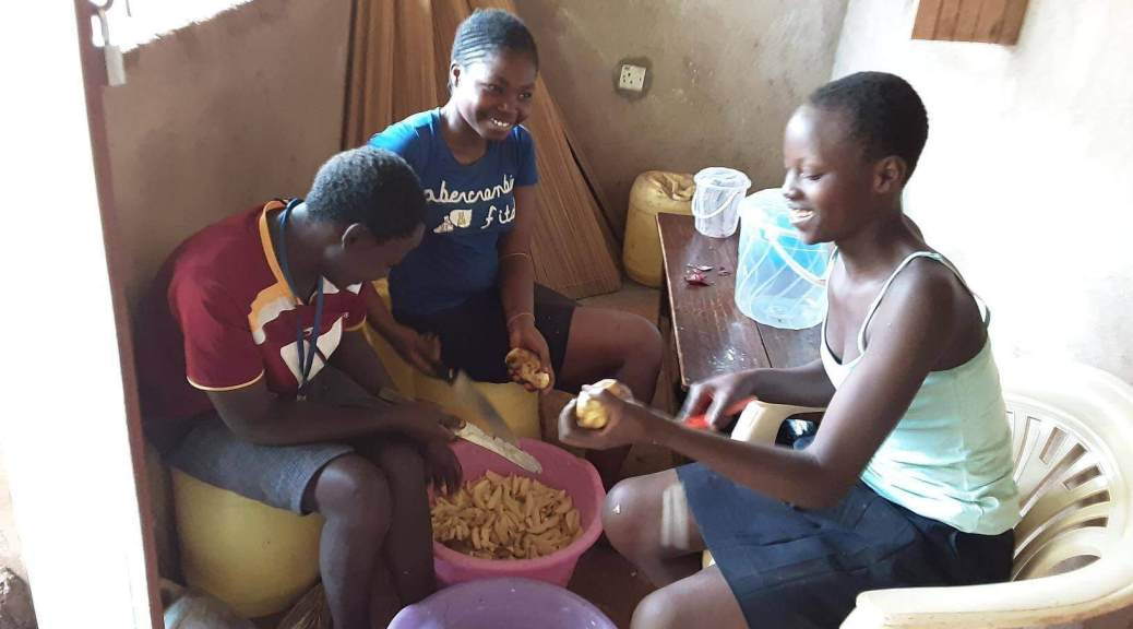 Three ideas, two months, and one student: girls peeling potatoes for their fundraiser in Kenya