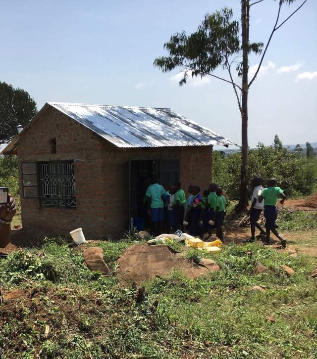 a small brick building used as a kitchen at Miruya Primary School in Kenya