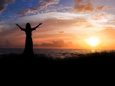 Woman beach sunrise.