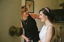 Rosie adding finishing touches to her Bridal Hair updo