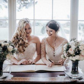 Two brides just married at Stubton Hall Newark. Wedding hair by Everyone's looking Rosie