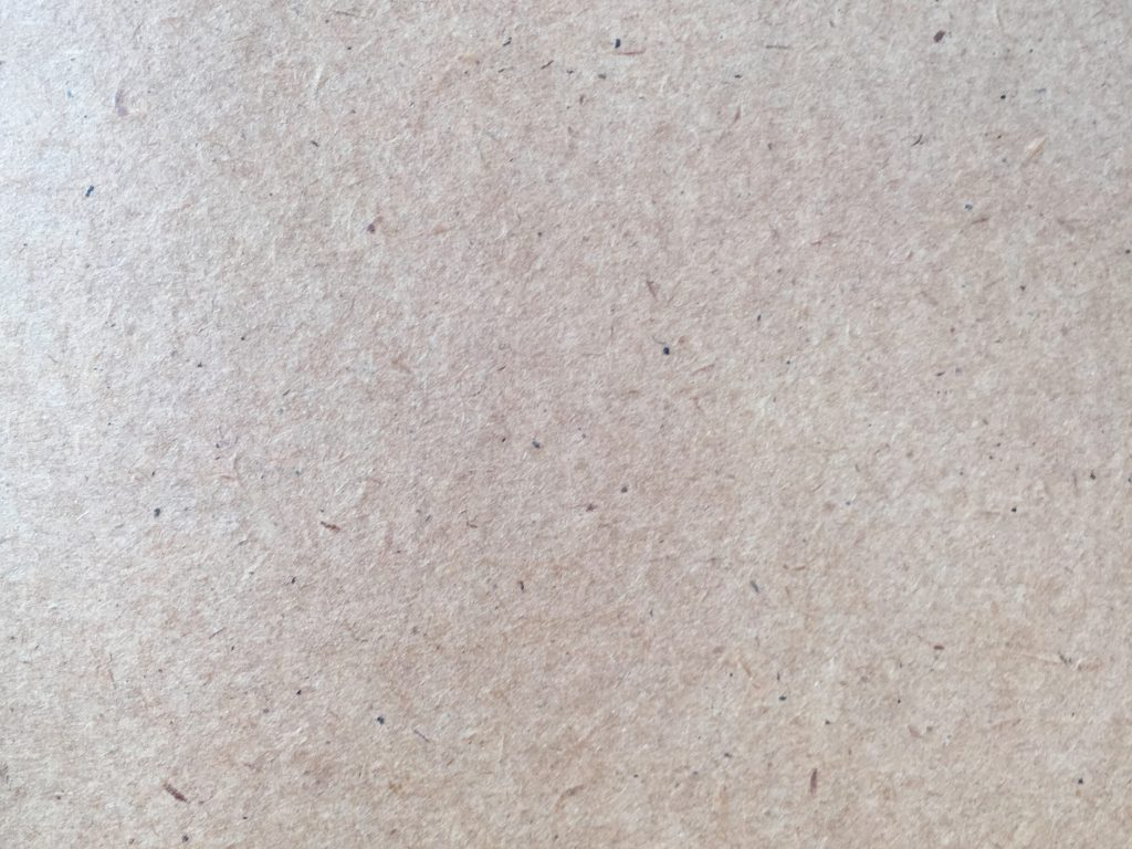 textured paper with specs
