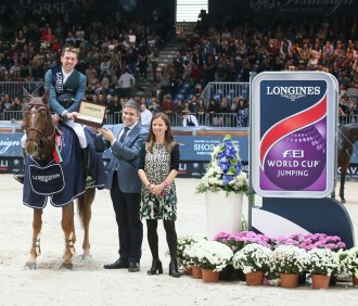 French winners Simon Delestre and Hermes Ryan pictured with Juan Carlos Capelli, Longines Vice-President and Head of International Marketing and Elisa Gasparini, Brand Manager Longines Italy after winning today's fourth leg of the Longines FEI World Cup™ Jumping 2015/2016 Western European League at Verona, Italy. (FEI/Stefano Secchi)