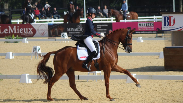 Charlotte Dujardin riding a flying change