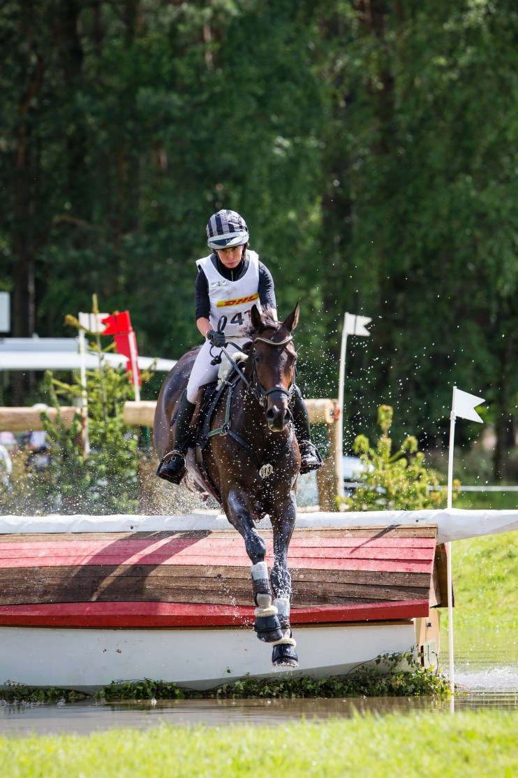 Bettina Hoy (GER) and Designer 10 maintain their lead after jumping clear inside the time cross country at Luhmühlen CCI 4* presented by DHL (GER), fifth leg of the FEI Classics™ (FEI/Eric Knoll)