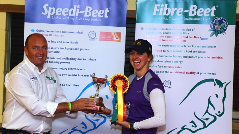 British Horse Feeds red dragon - Lauren Mills, winner of the Speedi-Beet Red Dragon receiving her prize from British Horse Feeds Martin Bielby.