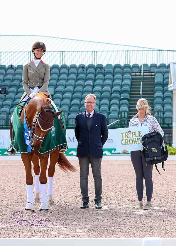 Heather Blitz with Swedish judge at C Bo Jena and Johnny Robb on behalf of Triple Crown Nutrition.